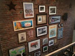 Art Gallery On A Brick Wall