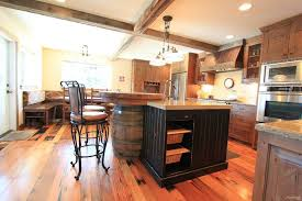 Rustic Style Kitchen With Wine Barrel Island Exposed Beams And Wood Flooring