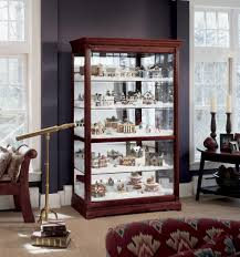 Curio Cabinet With Candle Holders And Telescope Also Beige Rug For Modern Interior Home Design