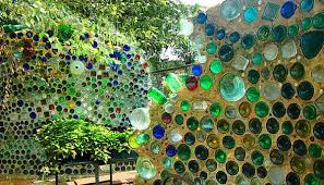 Recycled Cob Style Walls With Glass Bottles In Them At An Arts