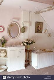 Oval Mirror Above Washbasin In Cupboard Unit In Cottage Bathroom ... Beach Cottage Bathroom Ideas Homswet Bathroom Mirror Ideas Rope With House Mirrors Ninjfuriclub Oval Mirror Above Whbasin In Cupboard Unit Images Vanity Small Designs Decor Remodel Beachy Best On Wall Theme Woland Music Fniture Enjoy The Elegant Fantastic Home Art Extraordinary Style Charming Country Bath Tastic