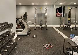 Basement gym features a mirrored accent wall lined with a flat panel