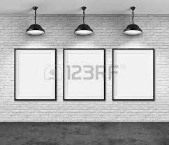 Art Gallery Blank Picture Frames On Brick Wall Background Photo