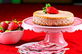 white chocolate strawberry cheesecake on serving stand