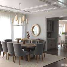 Contemporary Coastal Dining Room With Gray Chairs