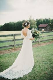 Picture Of Low Back Lace Wedding Dress With A Train