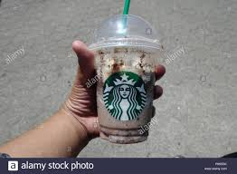 A Hand Holding Cup Of Double Chocolaty Chip Frappuccino From Starbucks Burnaby BC Canada