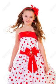pretty little blonde in a polka dot dress positive portrait
