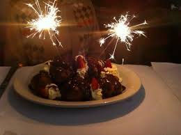 Fratinni Happy Birthday profiteroles with chocolate sauce cream and strawberries to share