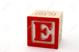 Letter E In A Alphabet Wood Block A White Surface Stock