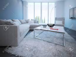 moderne wohnzimmer stil weiße und blaue wände dunkle holz frooring vom boden bis zur decke panoramafenster ecksofa und eleganter tisch mit