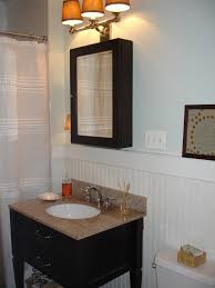 Small Double Sink Cabinet by Bathroom Lighting Over Round Mirror And Over Cabinet Lighting