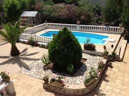 Easy And Awesome Landscaping Ideas: DIY Ultimate Guide Backyard Design Upgrades Pool Tropical With Coping Silk 11 Ways To Upgrade Your Mental Floss Nextlevel Outdoor Makeover Of A Bare Lifeless Best 25 Cheap Backyard Ideas On Pinterest Solar Lights 20 Yard Landscaping Ideas For Front And Small Spaces We Love Bob Vila Greek Escape Video Diy Budget Patio Easy 5 Cool Prefab Sheds You Can Order Right Now Curbed 50 Designs In 2017 36 Best Images About Faux Stone Landscape Se Wards Management
