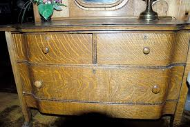 american oak dresser with swell front claw feet and french
