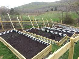 Awesome Raised Garden Beds On A Slope Angled Trellis For Cucumbers And Pic Of Soil Trend