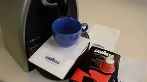 Lavazza Coffee An Italian Specialty In The Waffle Version For Espresso Machines Video Shot Moves From Left To Right And Makes A Game Of