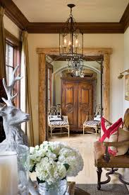 Country French Style Living Rooms by I Like The Rustic Wood Cased Opening Mixed With Traditional Or