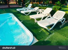White Plastic Chaise Lounge Chairs On Stock Photo (Edit Now ... Pool Interior Chaise Longue Armchair Chair Trees Colorful Stackable Patio Fniture Lounge Chair Alinum Carlsbad Gray Wicker Chaise Products In 2019 Couch Vintage Rhanciepointcom French Upholstered Homall Outdoor Adjustable Poolside Set Portable And Folding Pe Rattan 1 Chairs By The Stock Image Of Remarkable Cushions Amusing Cozy For Exciting Commercial Recliner Automatic Back With 100 Olefin Cushion Beige Coral Coast Emersin Sling Outdooraise Loungeair Amazoncom Wo Westin Outdoor Hermosa
