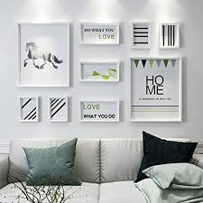 bilderrahmen collage fotowand wohnzimmer sofa hintergrund