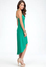 bebe solid high low dress in green lyst
