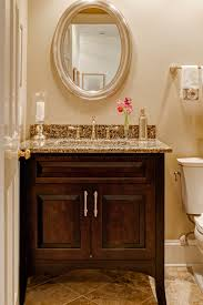 dark brown wooden vanity with storage and brown marble counter top