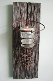 100 Year Old Barn Wood With Antique Rusty Bedspring And Vintage Hemingray Insulator Candle Holder From