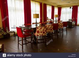 Formal Dining Room With Red And White Curtains Decor Seating For A Large Crowd Of 12 Persons