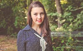 Teen Girl Dressed In Vintage Clothing Smiling Stock Photo