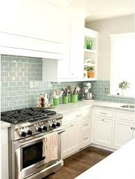 White Cabinets Dark Countertop Backsplash by Kitchen Backsplash Off White Cabinets White Granite Tile