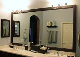 Black Wooden Frame Underneath Dark Brown Bathroom Vanity And Wall Mounted Track Lamps Combined Rectangle