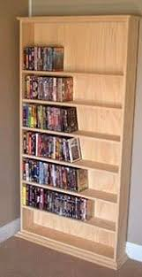 old wooden ladder dvd shelf one of the best diy we have done yet