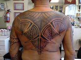 26 Dramatic Back Tribal Tattoos