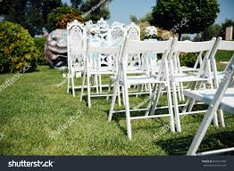 Rows White Folding Chairs On Lawn Stock Photo (Edit Now) 467614760 ... 40 Pretty Ways To Decorate Your Wedding Chairs Martha Stewart Weddings San Diego Party Rentals Platinum Event Monogram Decorations Ideas Inside Tables And 1888builders Spandex Folding Chair Cover Lavender Padded Hire For Outdoor Parties In Sydney Can Plastic Look Elegant For My Ctc 23 Decoration White Galleryeptune Aisle Metal Unique Reception Seating