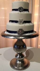 3 Tier Wedding Cake With Classic Ribbons At The Base Of Each