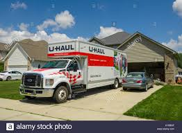 Uhaul Moving Truck Stock Photos & Uhaul Moving Truck Stock Images ... Uhaul Rental Moving Trucks And Trailer Stock Video Footage Videoblocks U Haul Truck Review Moving Rental How To 14 Box Van Ford Pod To Drive A With An Auto Transport Insider The Cap Stop Inc Online Rentals Pickup Frequently Asked Questions About Uhaul Brampton Trucks For Sale In Buffalo Ny Comparison Of National Companies Prices Enterprise Locations Best Resource Neighborhood Dealer Lancaster California Tavares Fl At Out O Space Storage Coupons For Cheap Truck