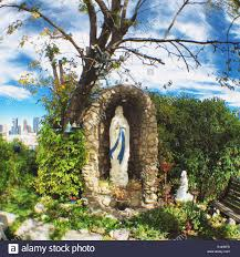 Virgin Mary Grotto In Backyard In Calgary Alberta Stock Photo ... Stunning Cave Pool Grotto Design Ideas Youtube Backyard Designs With Slides Drhouse My New Waterfall And Grotto Getting Grounded Charlotte Waterfalls Water Grottos In Nc About Pools Swimming Latest Modern House That Best 20 On Pinterest Showroom Katy Builder Houston Lagoon By Lucas Lagoons Style Custom With Natural Stone Polynesian Photo Gallery Oasis Faux Rock 40 Slide