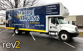 Box Truck Wraps- Secure Moving - REV2 Vehicle Wraps | Kansas City | Blog Big Truck Moving A Large Tank Stock Photo 27021619 Alamy Remax Moving Truck Linda Mynhier How To Pack Good Green North Bay San Francisco Make An Organized Home Move In The Heat Movers Free Wc Real Estate Relocation Cboard Box Illustration Delivery Scribble Animation Doodle White Background Wraps Secure Rev2 Vehicle Kansas City Blog Spy On Your Start Filemayflower Truckjpg Wikimedia Commons