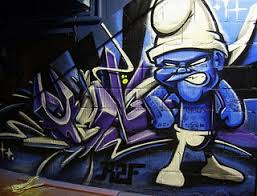 Above Tattoo Smurf Depicted In A Popular Graffiti Style