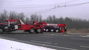 Pulling A Big Tow Truck Out Of The Ditch - YouTube