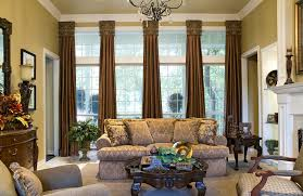 Living Room With Fireplace And Bay Window by Gold Window Curtains In Luxury Living Room With Fireplace And High