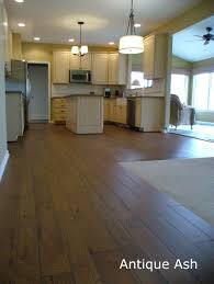 Ash Gunstock Hardwood Flooring by Fireplace Mantles Custom Mantles Panama City Fl