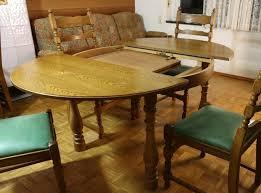 sitzgruppe runder tisch ausziehbar und 4 polsterstühle leder