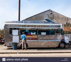 A Man Stands At A Taco Truck Serving Mexican Food In South Turlock ...