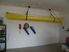 ceiling mounted shelving for the garage on a pulley system to