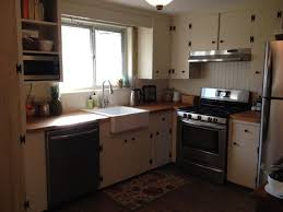 Kitchen Remodel On A Budget We Remodeled The In Our 1960s Ranch Painted Original Knotty Pine Cabinets With Rust