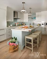 Beautiful White And Blue Cottage Kitchen Is Equipped With A Stunning Pale Island Topped Marble Countertop Seating Three Tan