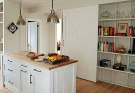 Beach House Kitchen Style With White And Wood Decorative Items On Shelving