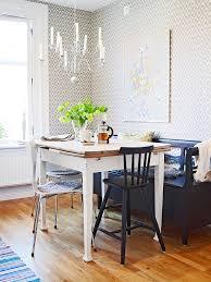 small kitchen nook deisgn at corner wth white and black furniture