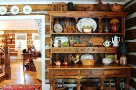 Inspiration For A Rustic Medium Tone Wood Floor Dining Room Remodel In New York