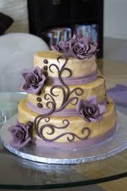 900 GclT gold and purple birthday cake